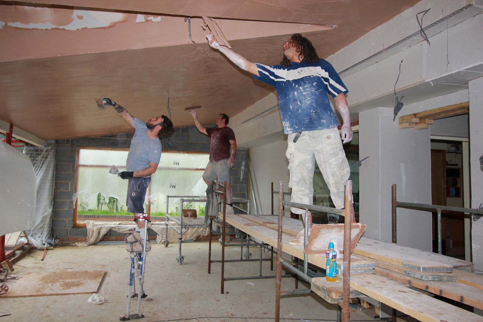 plasterers in action Morgan car Art Deco Showroom Expansion 2016